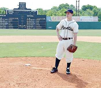 """Linc Hand stands on the pitcher's mound at Rickwood Field in Birmingham while filming a scene for """"42."""" The film follows baseball legend Jackie Robinson through his rookie season in the major leagues in 1947. Hand plays former Pittsburgh Pirates pitcher Fritz Ostermueller. Photo by: James Phillips"""